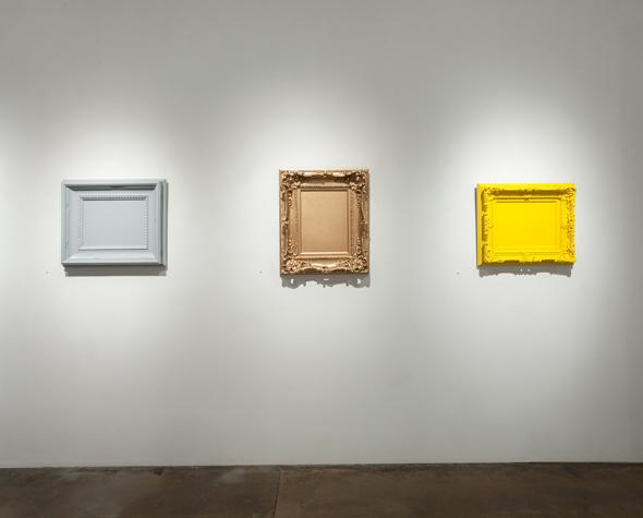 nstallation view of Matthew Deleget: Vanitas Vanitas (Pewter Gray), Vanitas (Bright Gold), Vanitas (Sun Yellow) Enamel spray paint on canvases and decorative frames