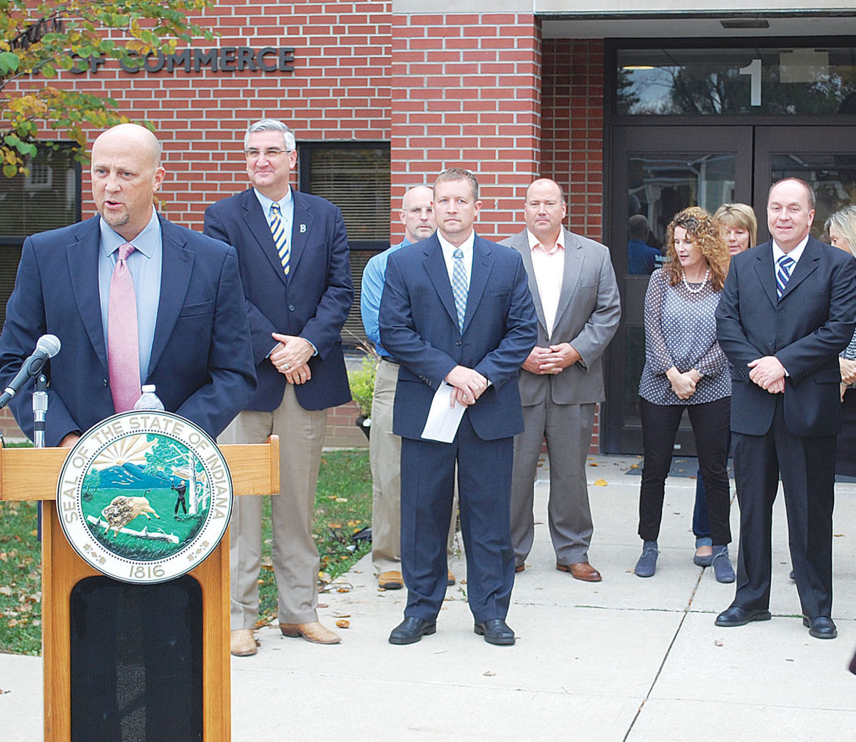 Mike McCarty '90 (left) and Crawfordsville Mayor Todd Barton '00 (far right) and press announcement on November 3)