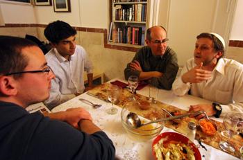 Wabash students breaking bread with Benjamin.