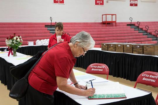 Melissa Butler H'85 signs in at Registration