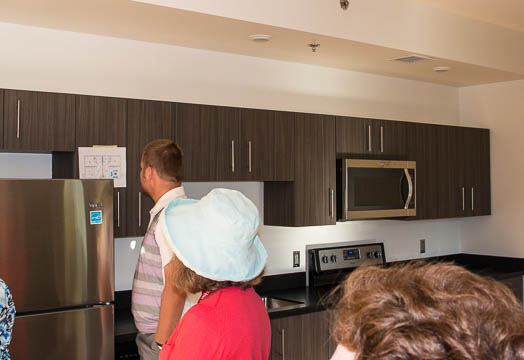 The kitchen features a stove, refrigerator, dish washer, and microwave.